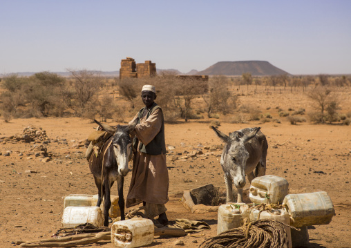 Sudan, Nubia, Naga, people taking water from a well in the desert