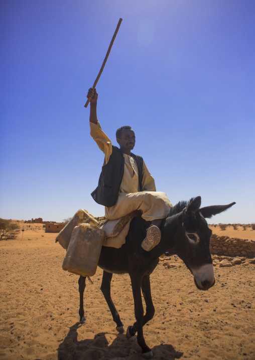 Sudan, Nubia, Naga, man riding a donkey