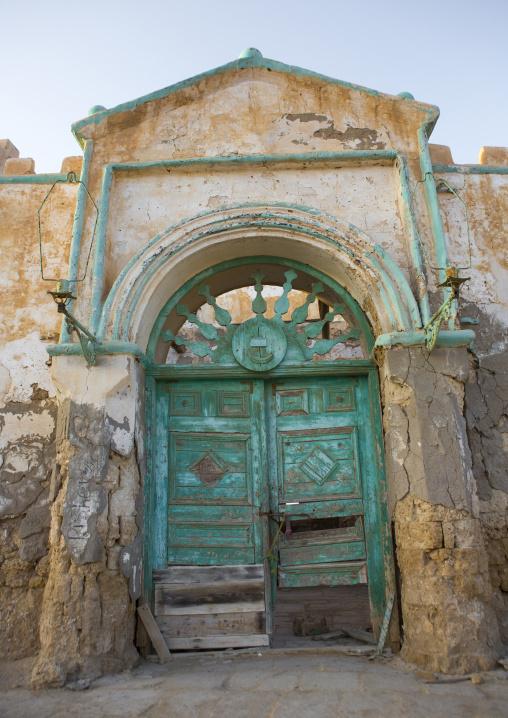 Sudan, Port Sudan, Suakin, huge green door of a ruined ottoman coral buildings