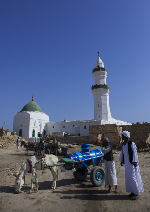 Sudan, Port Sudan, Suakin, man with a cart and a donkey in front of taj es-sir mosque on mainland el-geyf