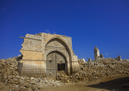 Sudan, Port Sudan, Suakin, wodden door in the middle of a ruined ottoman coral buildings