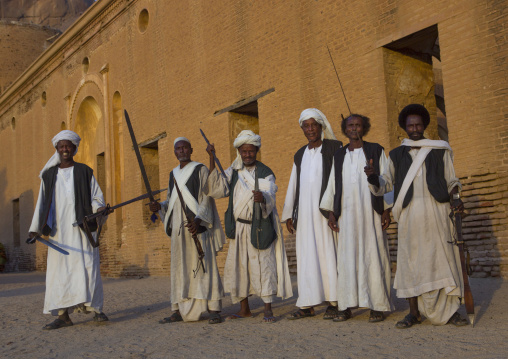 Sudan, Kassala State, Kassala, beja tribe men dancing in front of the khatmiyah mosque at the base of the taka mountains