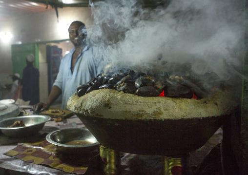 Sudan, Kassala State, Kassala, meat cooked on heated stones