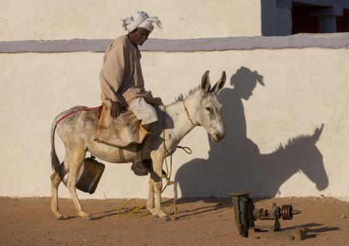 Sudan, Nubia, Soleb, man riding a donkey