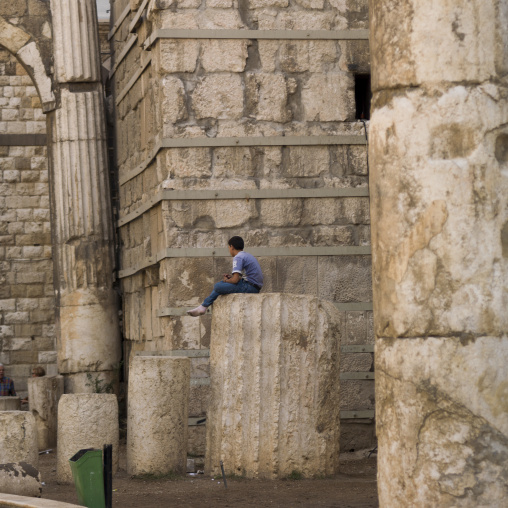 Kid Sit On A Roman Column In Damascus, Syria