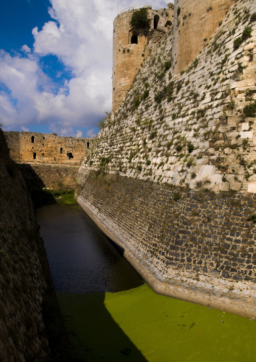 The walls and moat of Krac des Chevaliers, Syria