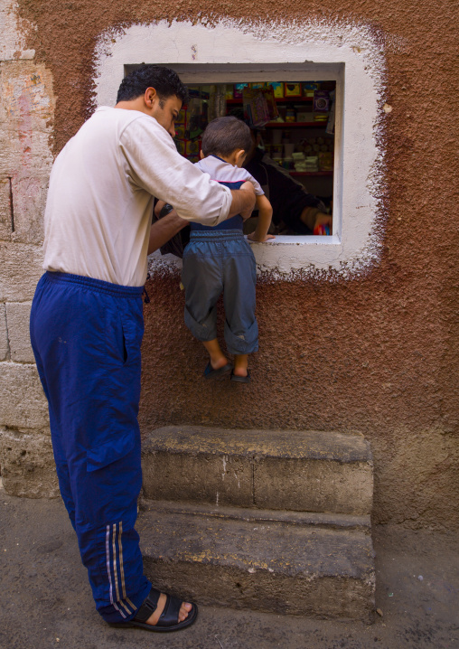 Father And Son Looking Into A Bakery, Damascus, Syria