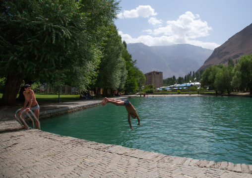 Teenage boys diving in the pool of Khorog city park, Gorno-Badakhshan autonomous region, Khorog, Tajikistan
