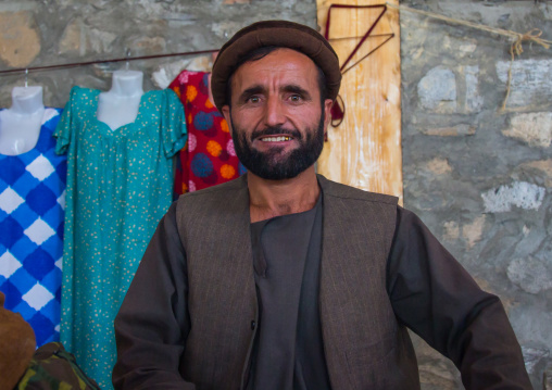 Portrait of a smiling afghan man in the market border with Afghanistan, Central Asia, Ishkashim, Tajikistan