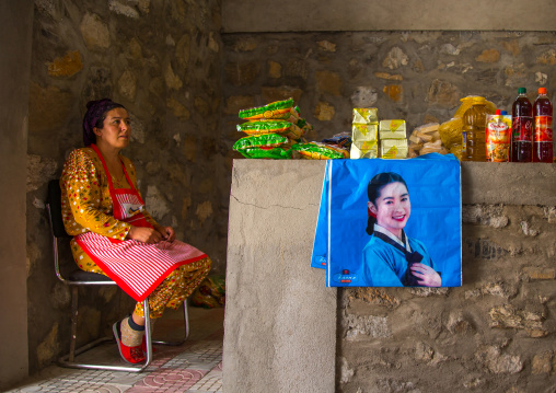 Tajik woman selling food and drinks in the market border with Aghanistan, Central Asia, Ishkashim, Tajikistan