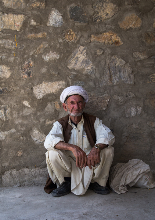 Portrait of an old afghan man in the market border with Afghanistan, Central Asia, Ishkashim, Tajikistan