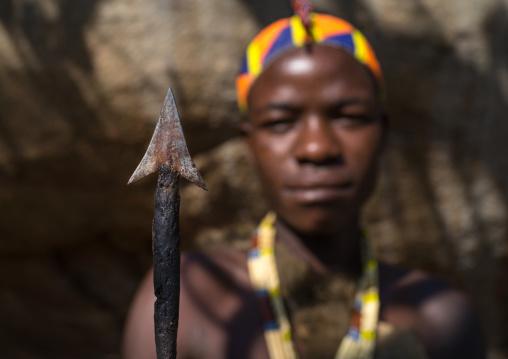 Tanzania, Serengeti Plateau, Lake Eyasi, hadzabe tribe holding an arrow