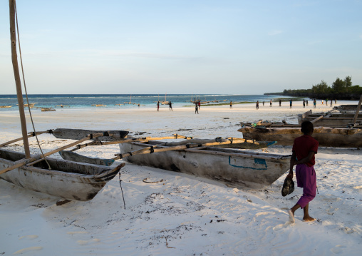 Tanzania, Zanzibar, Matemwe, wooden fishing dhows resting on a sandy beach