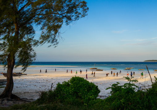 Tanzania, Zanzibar, Matemwe, children playing football on muyuni sandy beach