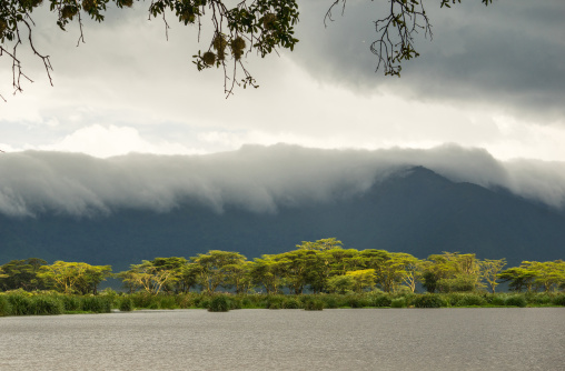 Tanzania, Arusha Region, Ngorongoro Conservation Area, clouds over landscape and mountain range