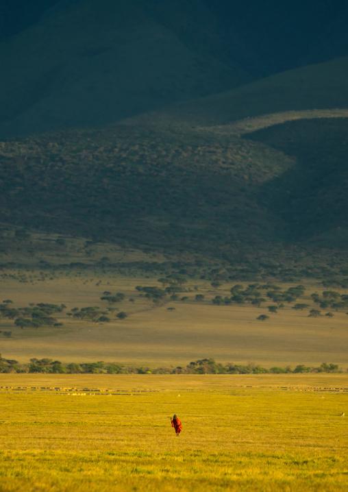 Tanzania, Arusha Region, Ngorongoro Conservation Area, maasai old man walking alone in the bush