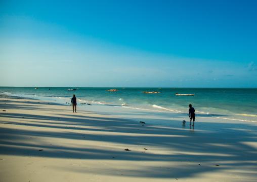 Tanzania, Zanzibar, Jambiani, children playing football on a white beach