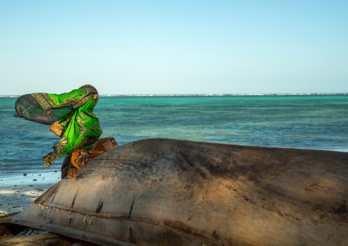 Tanzania, Zanzibar, Kizimkazi, veiled muslim woman looking away at the sea