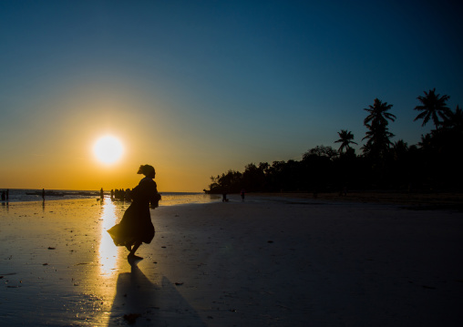 Girl Running On Beach During Sunset