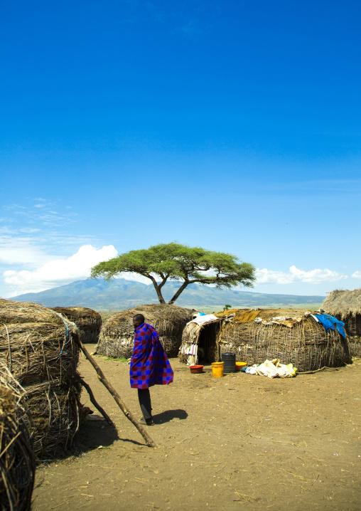 Tanzania, Ashura region, Ngorongoro Conservation Area, maasai man outside his home