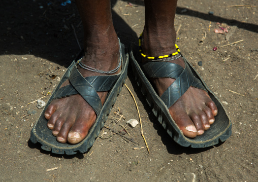 Tanzania, Ashura region, Ngorongoro Conservation Area, close up of leather sandals and intricate beadwork on the maasai men feet