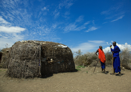 Tanzania, Ashura region, Ngorongoro Conservation Area, maasai cmen outside their home