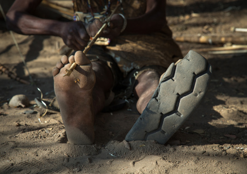 Tanzania, Serengeti Plateau, Lake Eyasi, hadzabe tribe man shoes made from a car tyre