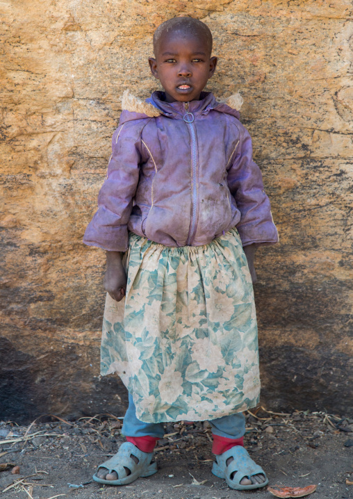 Tanzania, Serengeti Plateau, Lake Eyasi, hadzabe tribe girl with modern clothes