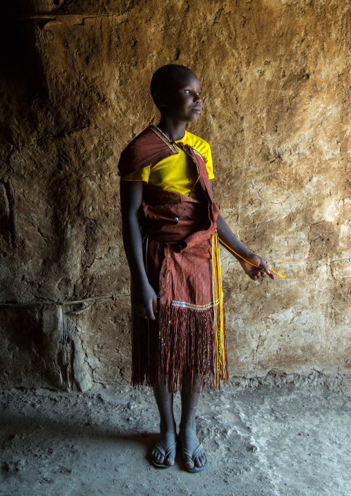 Tanzania, Serengeti Plateau, Lake Eyasi, datoga tribe woman wearing a leather dress