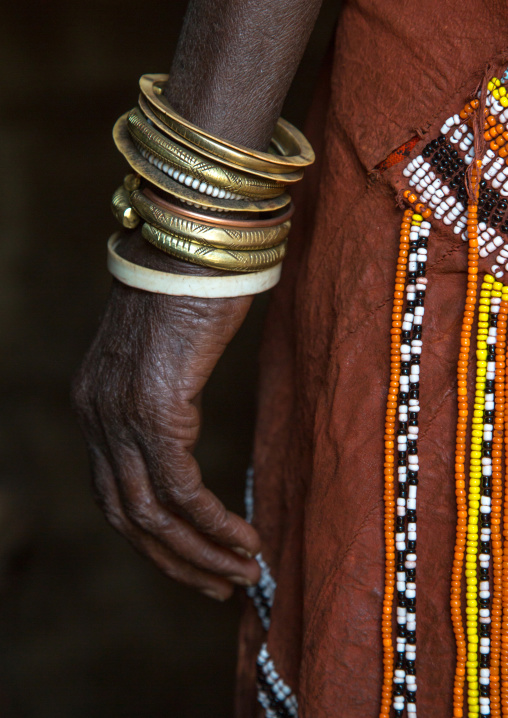 Tanzania, Serengeti Plateau, Lake Eyasi, the numerous decorated iron, brass, copper and leather bracelets worn by a datoga woman