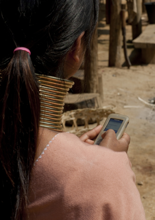 Long neck texting on phone, Thailand