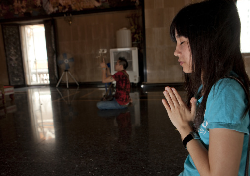 Women praying in a temple, Bangkok, Thailand