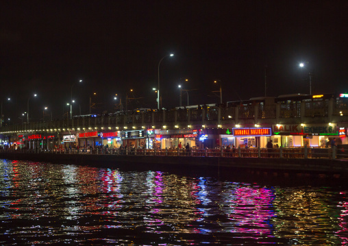 Restaurants under Galata bridge at night, Galata, istanbul, Turkey