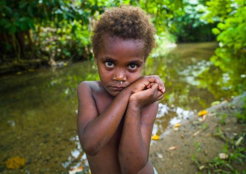 Portrait of a shy Ni-Vanuatu blonde hair girl, Efate island, Port Vila, Vanuatu