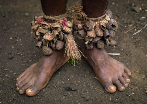 Tribesman with dried seeds on the feet during the palm tree dance of the Small Nambas tribe, Malekula island, Gortiengser, Vanuatu