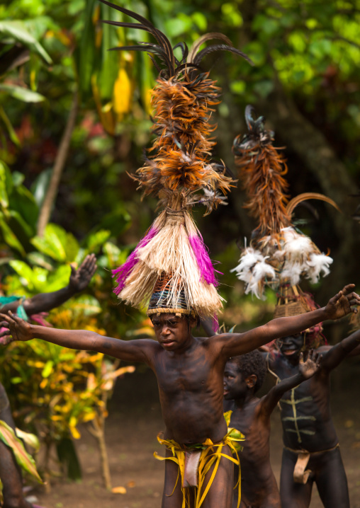 Small Nambas tribesmen with Big headdresses dancing during the palm tree dance, Malekula island, Gortiengser, Vanuatu
