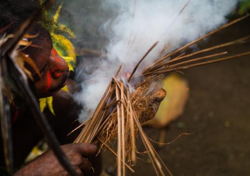 Small Nambas tribe man starting a fire, Malekula island, Gortiengser, Vanuatu