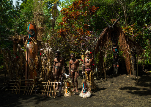 Portrait of chieftain Etul and his sons in front of the nakamal, Ambrym island, Fanla, Vanuatu