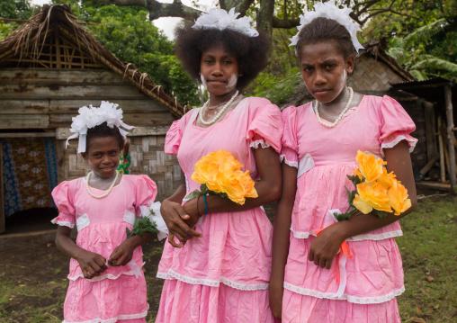 Bridesmaids wearing matching pink patterned dresses, Malampa Province, Ambrym island, Vanuatu