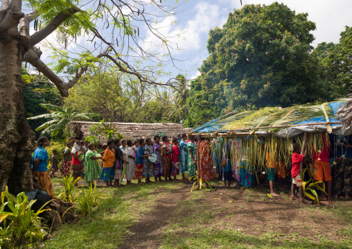 Women queueing to offer gifts to the bride and the groom during a traditional wedding, Malampa Province, Ambrym island, Vanuatu