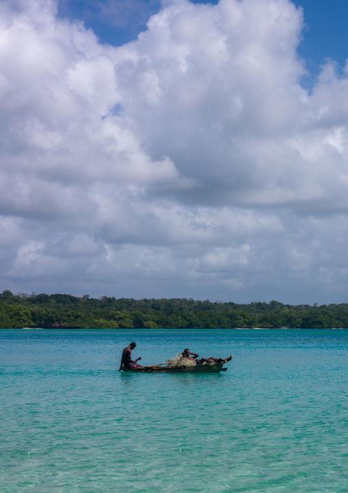 Young boys of the Ni-Vanuatu people paddling in their dugout, Sanma Province, Espiritu Santo, Vanuatu