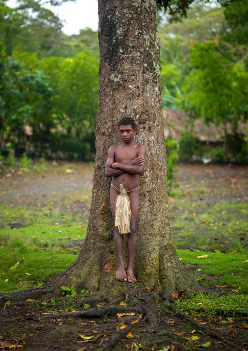 Teenage boy wearing a penis sheath called a namba, Tanna island, Yakel, Vanuatu