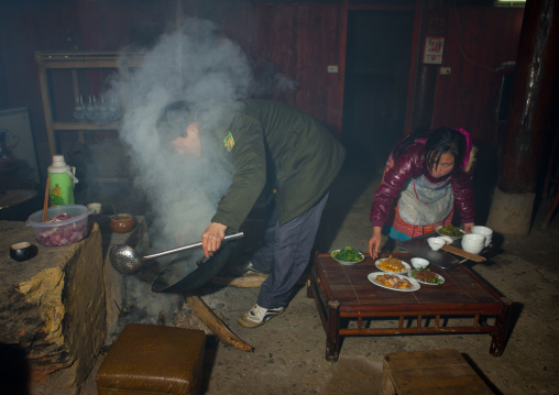 Couple cooking in their kitchen, Sapa, Vietnam