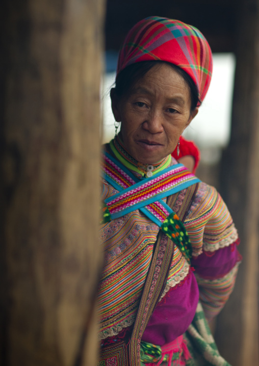 Old flower hmong woman in traditional dress, Sapa market, Vietnam