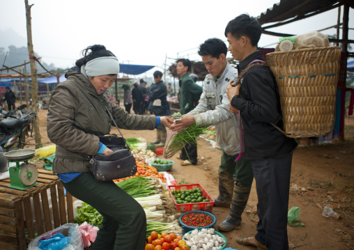 Woman buying vegetables at sapa market, Vietnam