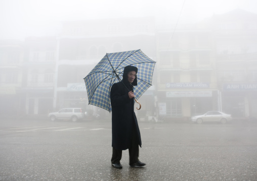 Man under an umbrella in sapa, Vietnam