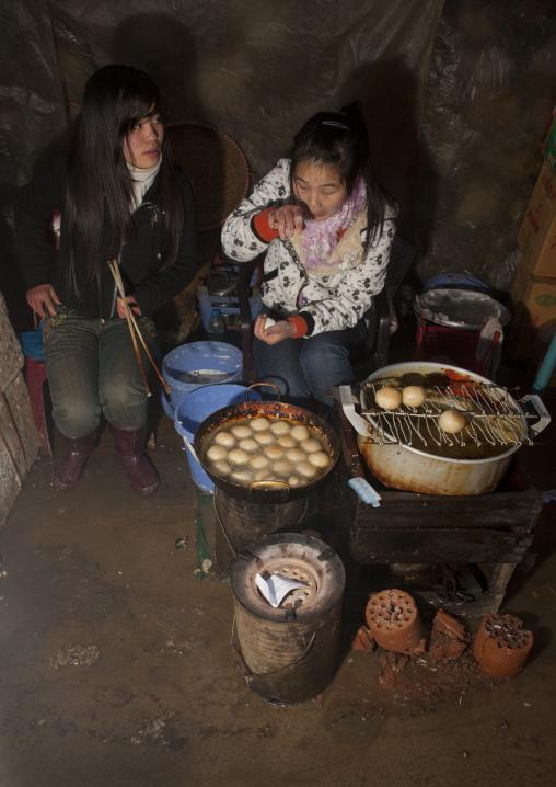 Black hmong girls cooking, Sapa, Vietnam