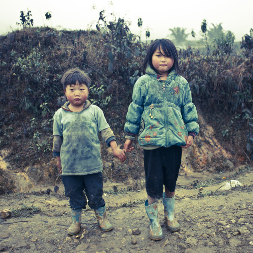 Black hmong brother and sister holding each other s hand, Sapa, Vietnam
