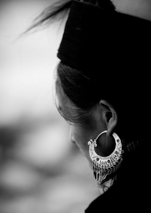 Black hmong woman wearing a big earring, Sapa, Vietnam