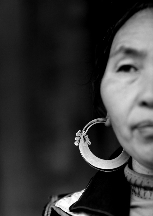 Black hmong woman wearing a big earring, Sapa, Vietnam